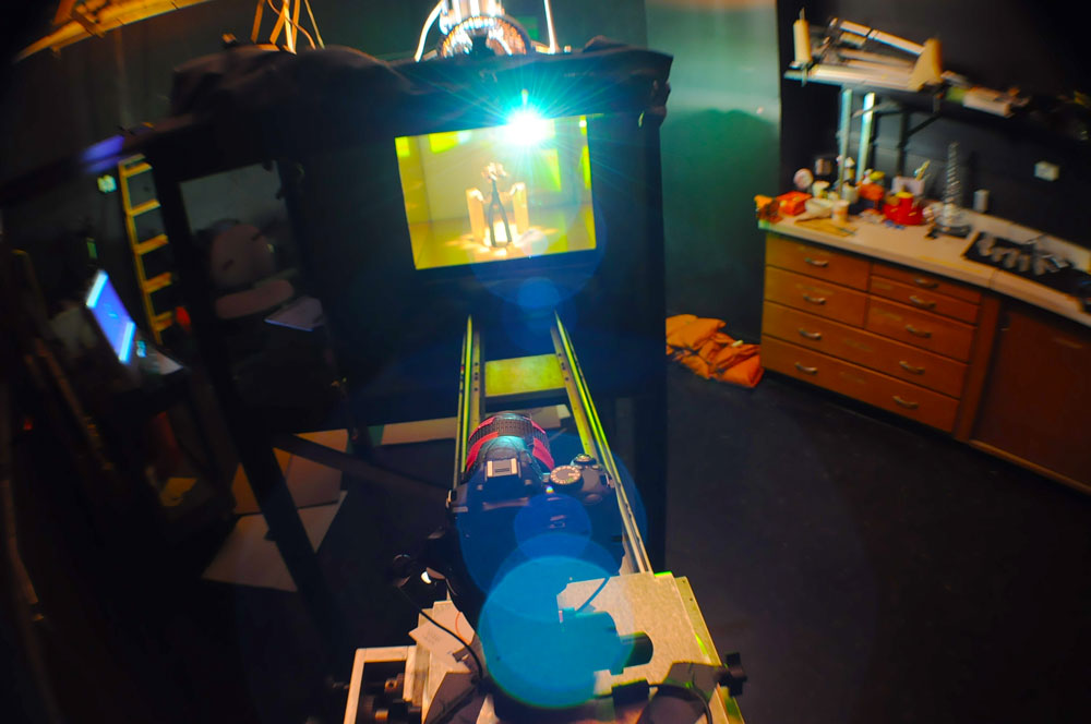Stop-motion dolly into the mirror box