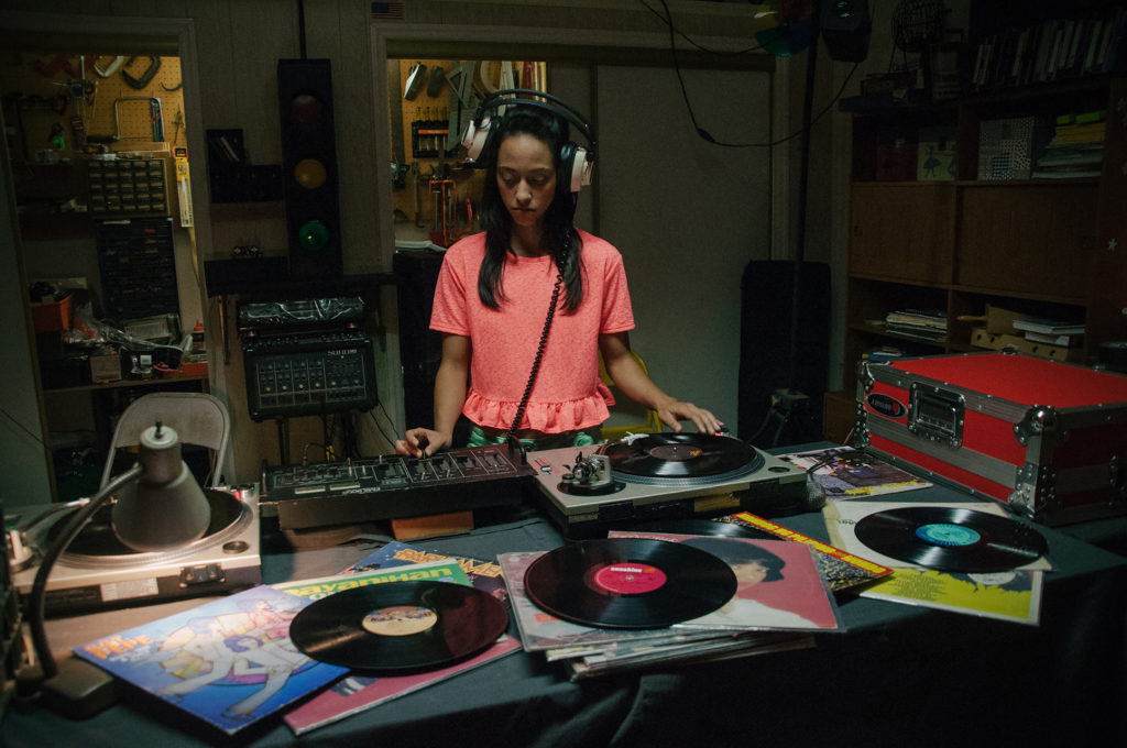 Vanessa (Courtney Bandeko) teaches herself how to DJ.